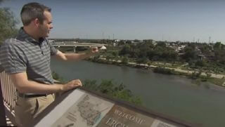 Reporter on stand overlooking the Rio Grande.
