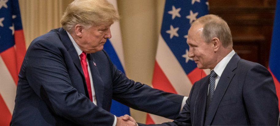 U.S. President Donald Trump (L) and Russian President Vladimir Putin shake hands during a joint press conference after their summit on July 16, 2018, in Helsinki, Finland.