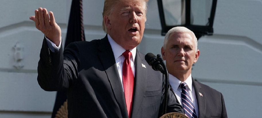 Trump at microphone with Pence in the background
