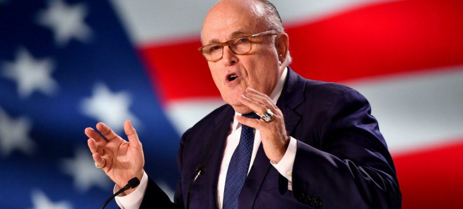 Giuliani in front of an American flag