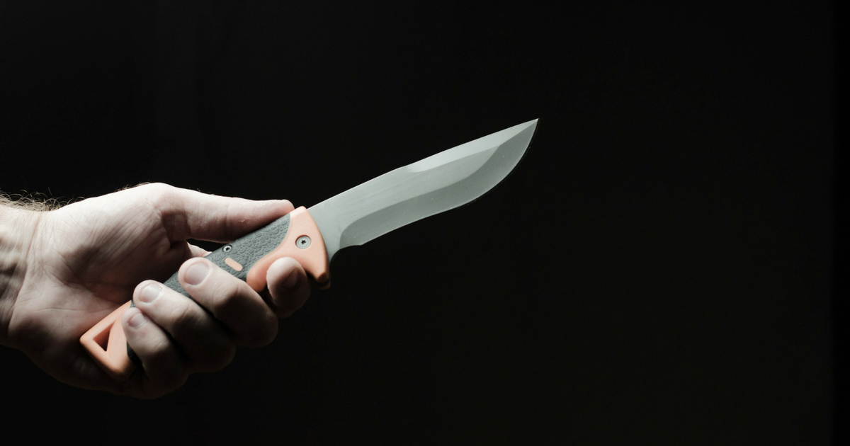 knife in a hand on dark background