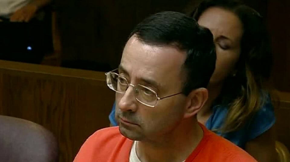 Convicted sex abuser Larry Nassar sits in court