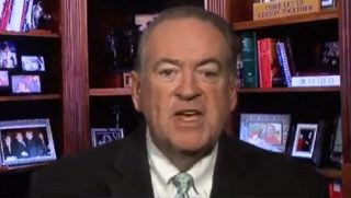 Mike Huckabee speaking directly to the camera.