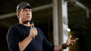 TV personality Mike Rowe , host of 'Dirty Jobs', takes part in a roundtable discussion on manufacturing with Republican presidential candidate Mitt RomneySeptember 26, 2012 American Spring Wire in Bedford Heights, Ohio.