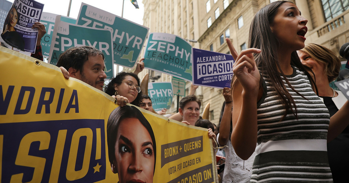 Congressional nominee Alexandria Ocasio-Cortez stands with Zephyr Teachout after endorsing her for New York City public advocate on July 12, 2018, in New York City. The two liberal candidates held the news conference in front of the Wall Street bull in a show of standing up to corporate money.