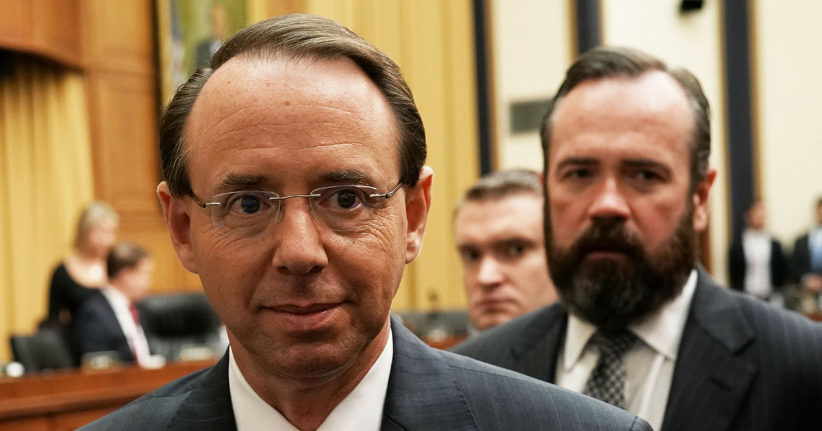 U.S. Deputy Attorney General Rod Rosenstein (L) leaves after a hearing before the House Judiciary Committee