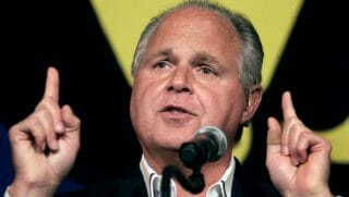 Rush Limbaugh speaks into a microphone.