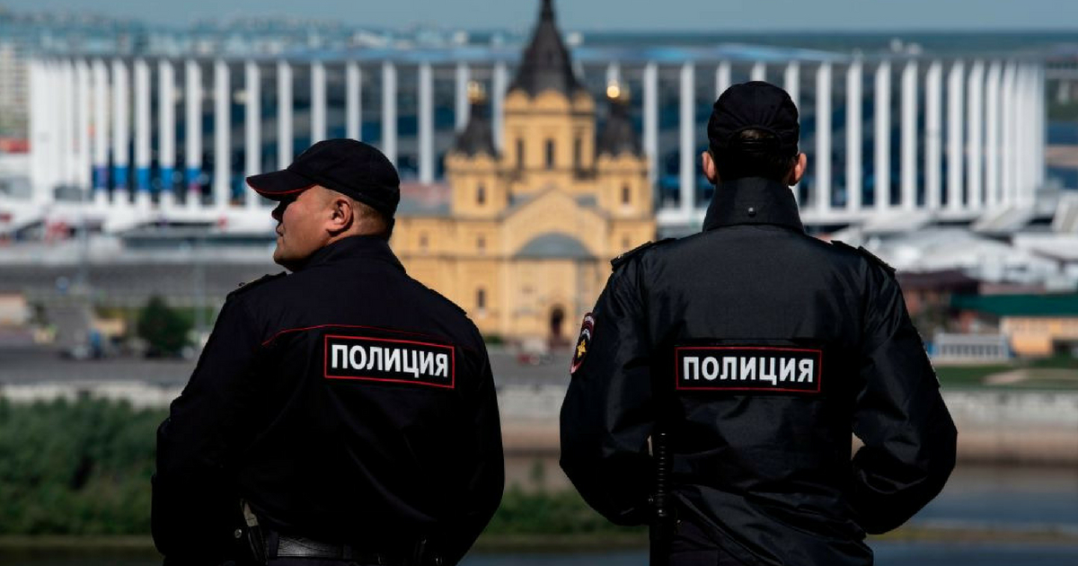 Policemen stand guard overlooking the Nizhny Novgorod stadium situated behind the cathedral of Alexandr Nevskiy in the city of Nizhny Novgorod during the Russia 2018 World Cup football tournament on June 16, 2018.