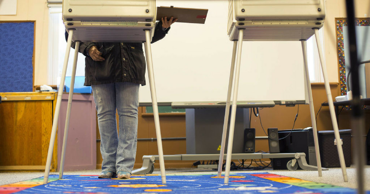 A voter casts her ballot for Montana's special House election between Republican Greg Gianforte and Democrat Rob Quist in one of the two voting booths at the polling place at Basin Elementary School on May 25, 2017 in Basin, Montana.