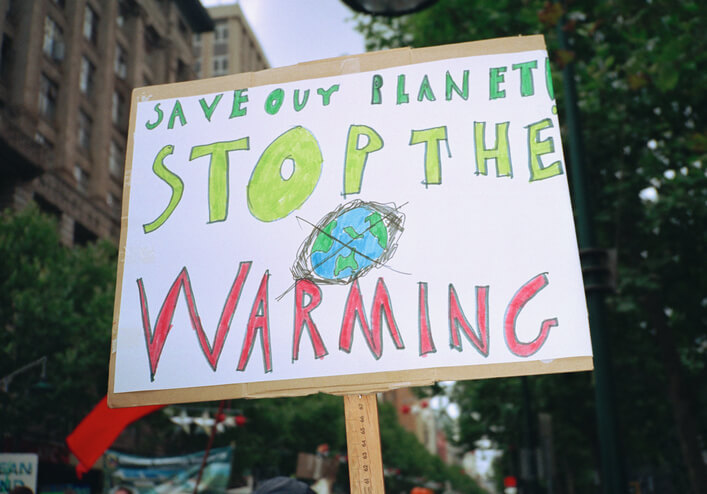 Failed global warming predictions: Global Warming sign that says Save out planet! Stop the warming.