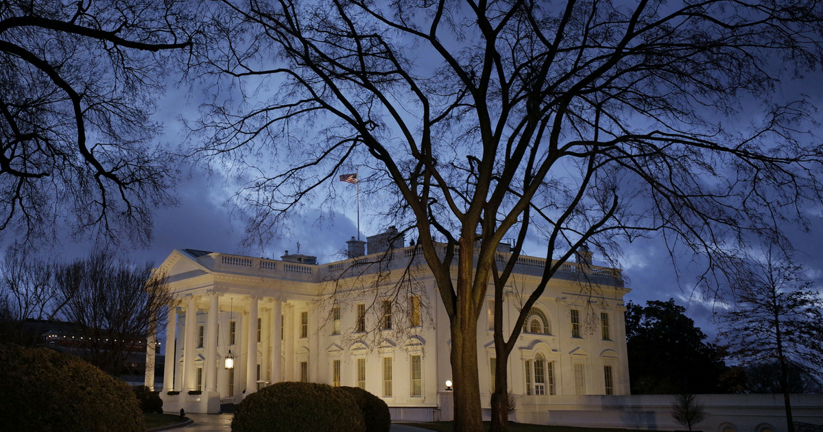 The White House is seen under a stormy sky on February 24, 2016, in Washington, D.C.