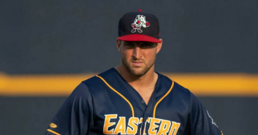 Tim Tebow warms up before the 2018 Eastern League All-Star Game.