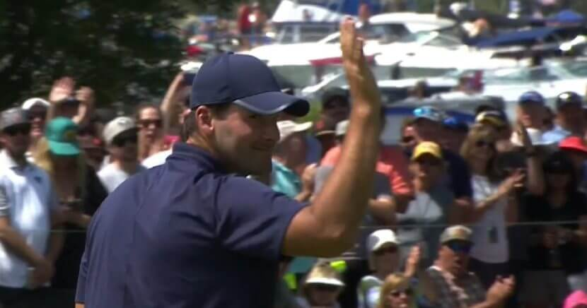 Tony Romo waves to the crowd as he walks off the 18th green and winning the 2018 American Century Championship golf tournament