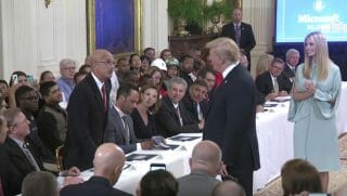 A Marine puts down his mic and tells President Trump that he is working with some good people.
