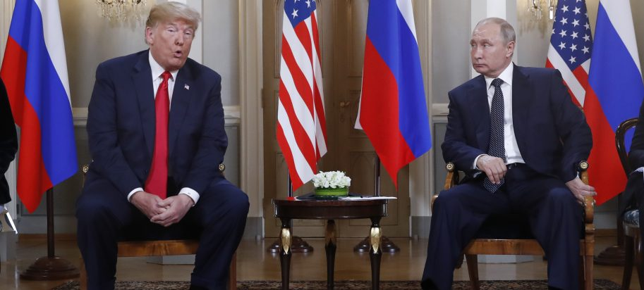 U.S. President Donald Trump gives a statement as Russian President Vladimir Putin looks on