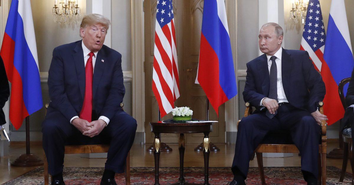 U.S. President Donald Trump gives a statement as Russian President Vladimir Putin looks on