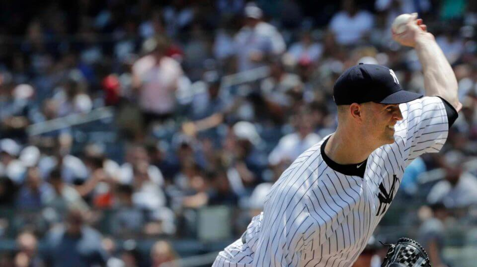 New York Yankees' J.A. Happ delivers a pitch against the Kansas City Royals