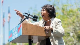 Maxine Waters speaking at podium