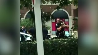 Police grab baby away from bank robber.