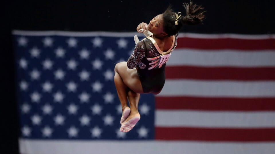 Simone Biles competes on the uneven bars at the U.S. Gymnastics Championships, Friday in Boston.