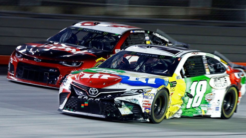 Kyle Busch (18) gets past Austin Dillon during the NASCAR Cup Series race Saturday in Bristol, Tenn.