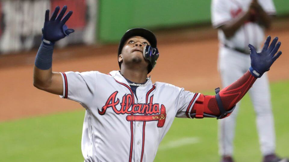 Atlanta Braves outfielder Ronald Acuna Jr. reacts after hitting a solo home run during the third inning of the team's baseball game against the Miami Marlins on Thursday in Miami.