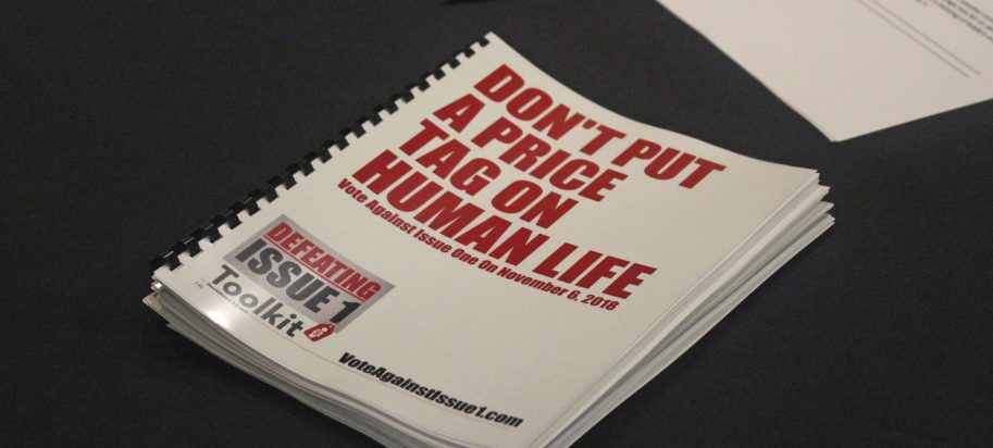 """In this July 26, 2018 photo, an information booklet about a """"tort reform"""" measure appearing on Arkansas' ballot sits on a table at a breakfast meeting of pastors in Little Rock, Arkansas. The Family Council Action Committee, a conservative Christian group, is rallying churches against the ballot measure to impose new limits on lawsuit damages."""