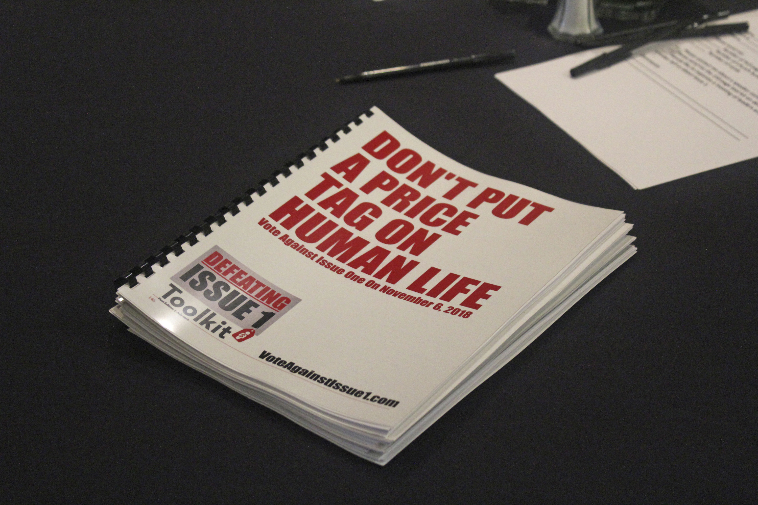 "In this July 26, 2018 photo, an information booklet about a ""tort reform"" measure appearing on Arkansas' ballot sits on a table at a breakfast meeting of pastors in Little Rock, Arkansas. The Family Council Action Committee, a conservative Christian group, is rallying churches against the ballot measure to impose new limits on lawsuit damages."