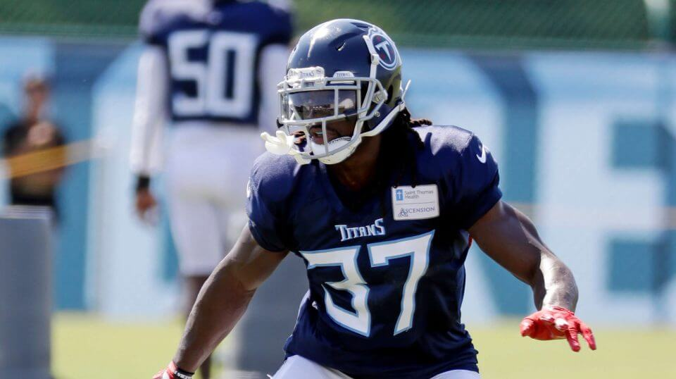 FILE - In this July 29, 2018, file photo, Tennessee Titans defensive back Johnathan Cyprien runs a drill during NFL football training camp in Nashville, Tenn. Cyprien will miss the season with a torn left ACL, and coach Mike Vrabel says veteran Eric Reid is among the safeties the Titans want to look at for a potential replacement. Cyprien left practice Wednesday, Aug. 1, 2018, after grabbing at his left knee.