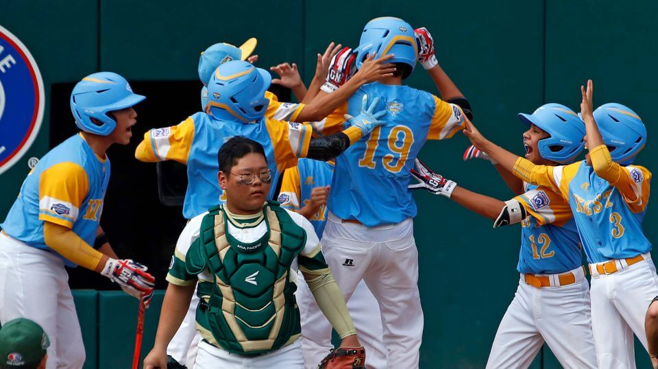 South Korea catcher Gi Jeong Kim, walks to the mound as Honolulu, Hawaii's Mana Lau Kong (19) is greeted by teammates after hitting the first pitch of the game for a solo home run in the first inning of the Little League World Series Championship in South Williamsport, Pa., Sunday, Aug. 26, 2018.