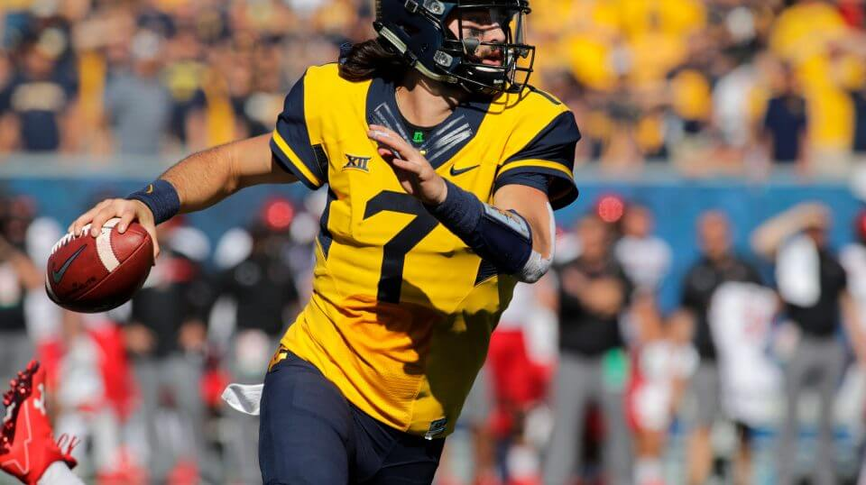 In this Oct. 14, 2017, file photo, West Virginia quarterback Will Grier (7) looks to pass against Texas Tech during an NCAA college football game in Morgantown, W.Va. While the Sooners are still the preseason favorite again, there are also high expectations for Grier, the preseason Big 12 offensive player of the year who threw 34 touchdowns and 3,490 yards in his injury-shortened WVU debut.