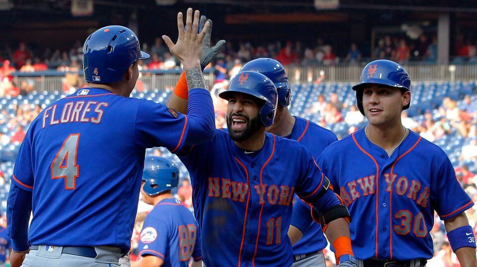 New York Mets' Jose Bautista, center, high-fives Wilmer Flores after Bautista hit a grand slam during the fifth inning of a baseball game against the Philadelphia Phillies on Thursday in Philadelphia.