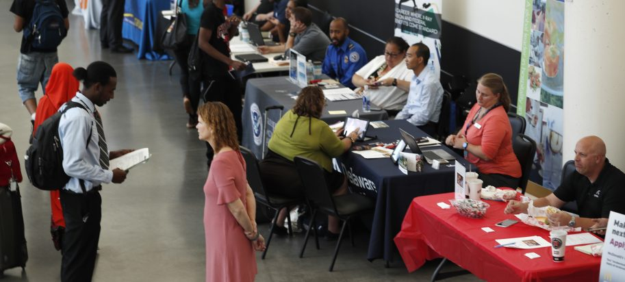 Job seekers crowd a jobs fair in Minnesota