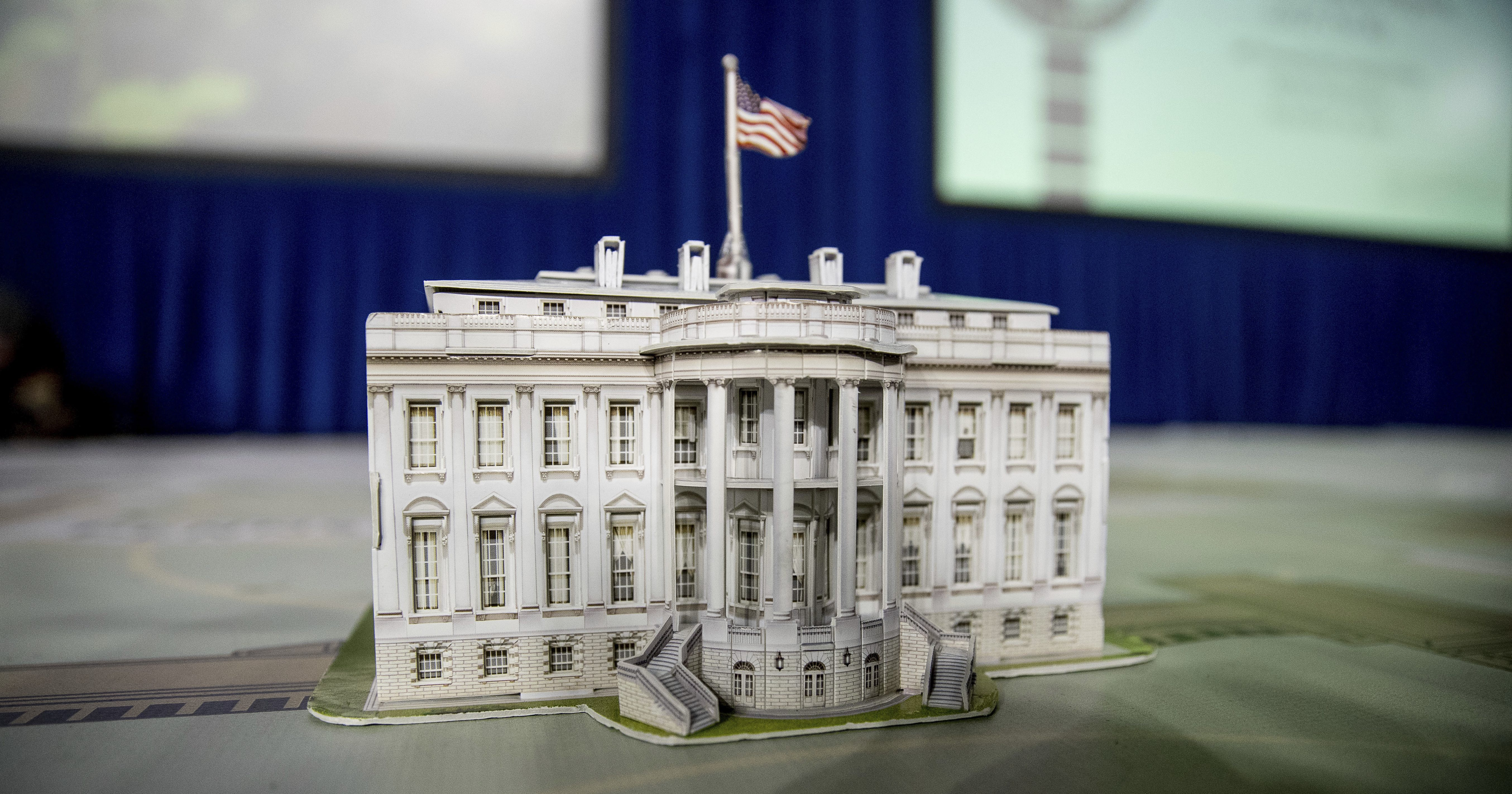 A model of the White House is displayed.