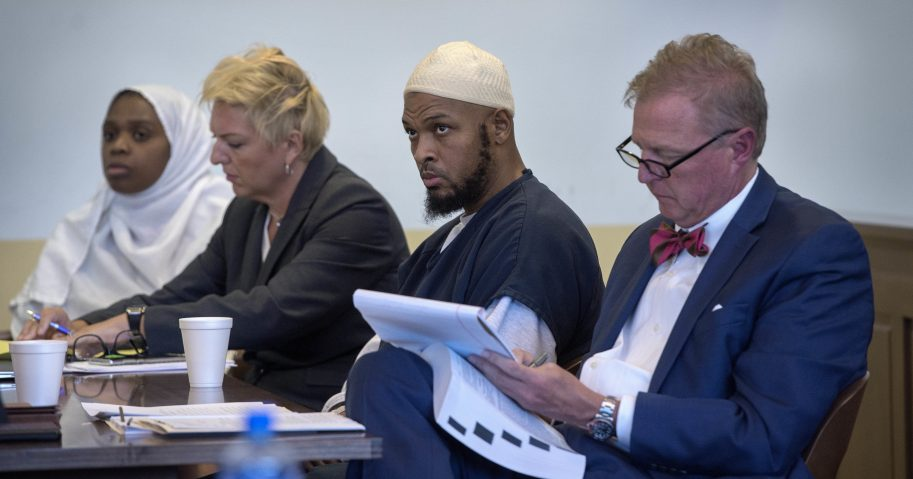 Jany Leveille, from left, with her attorney Kelly Golightley, and Siraj Ibn Wahhaj with attorney Tom Clark listen to the prosecutor during a hearing on a motion to dismiss in the Taos County Courthouse.