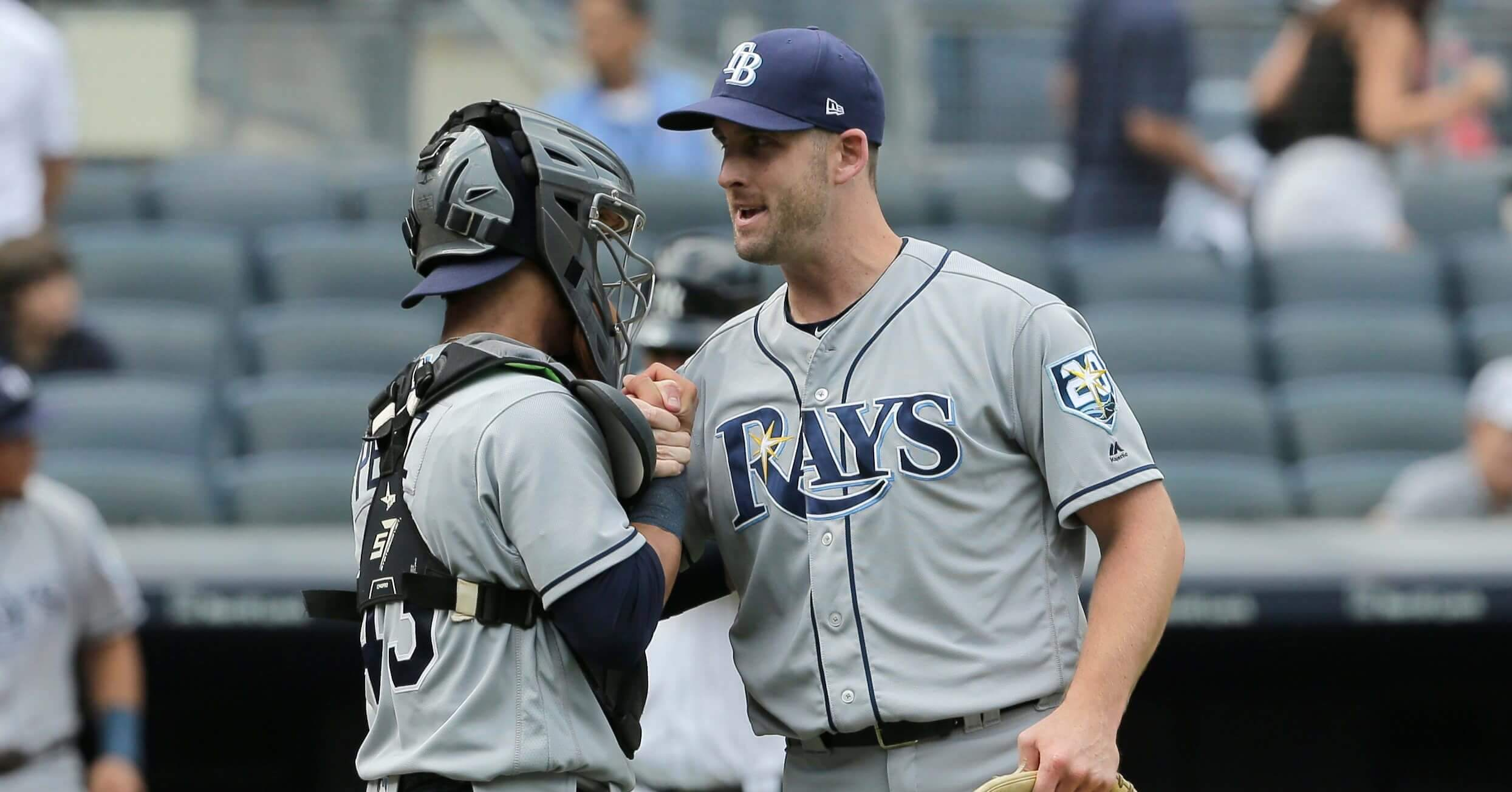 Tampa Bay Rays relief pitcher Adam Kolarek, right, and catcher Michael Perez celebrate after the ninth inning of a baseball game against the New York Yankees at Yankee Stadium Thursday