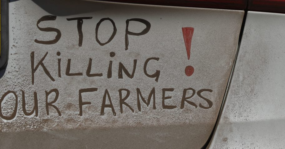 In this file photo dated Oct. 30 2017, a bumper sign calls for the end of farm killings in South Africa, during a blockade of a freeway in Midvaal, South Africa.