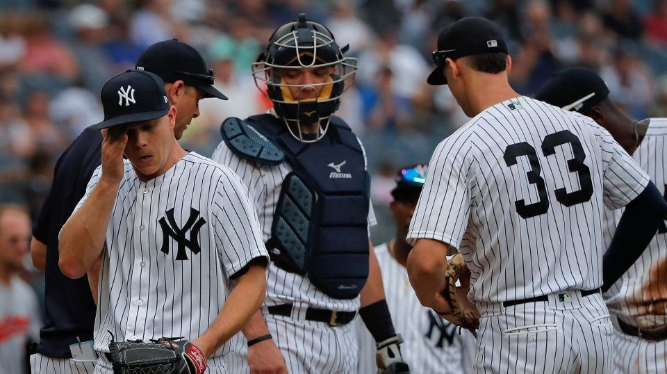 New York Yankees starting pitcher Sonny Gray, left, leaves the mound as he is relieved during the third inning of a baseball game against the Baltimore Orioles, Wednesday, Aug. 1, 2018, in New York.