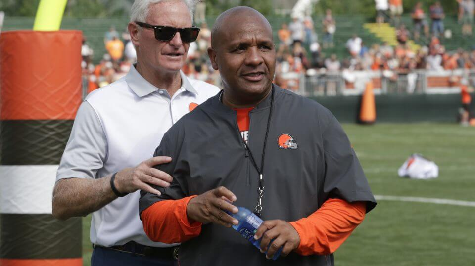 Cleveland Browns owner Jimmy Haslam, left and head coach Hue Jackson watch during NFL football training camp, Monday, July 30, 2018, in Berea, Ohio.