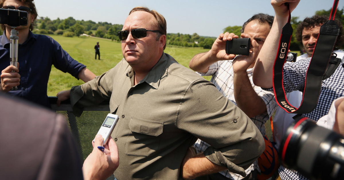 Alex Jones (C), an American radio host, author and conspiracy theorist, addresses media and protesters in the protester encampment outside The Grove hotel, which is hosting the annual Bilderberg conference, on June 6, 2013 in Watford, England.