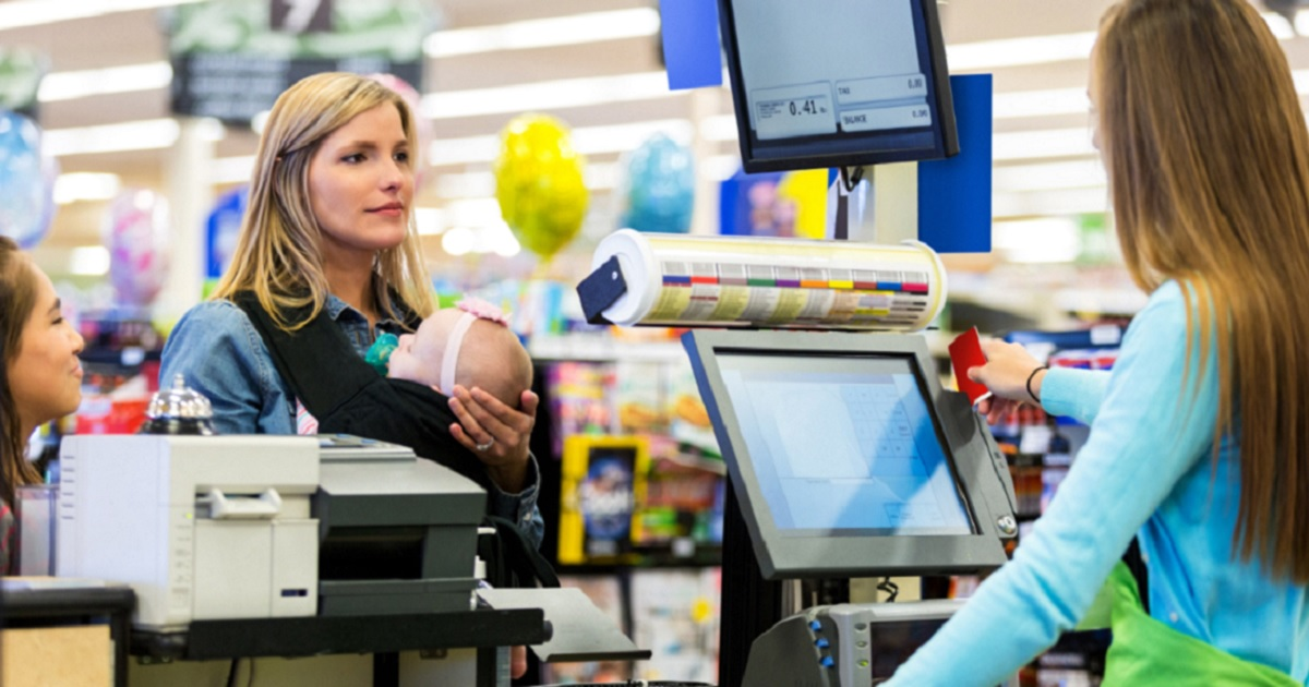 Woman and daughter in line at cash register.