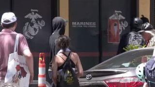 "Thugs outside an office with the word ""Marines"" on the window"