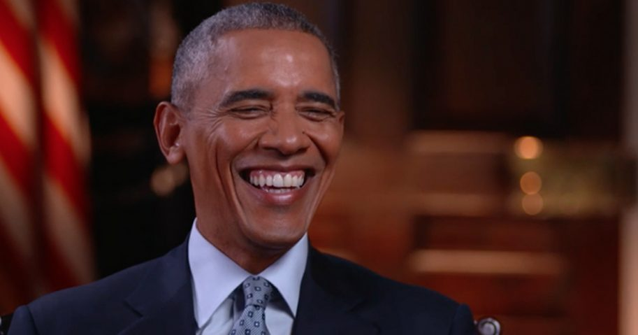 Former president Barack Obama laughs during in an interview with HBO's Bill Maher