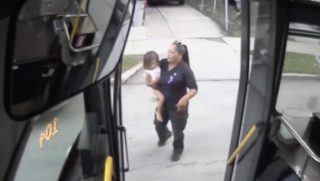 A bus driver finds a toddler walking near the road and picks her up to safety.