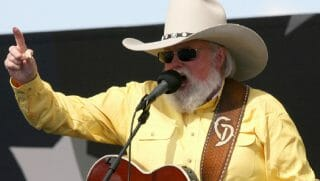 Charlie Daniels with guitar not shown.