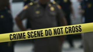 "Police crime scene tape that reads ""Crime Scene Do Not Cross"""
