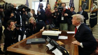 U.S. President Donald Trump talks with journalists after signing tax reform legislation into law in the Oval Office December 22, 2017 in Washington, DC. Trump praised Republican leaders in Congress for all their work on the biggest tax overhaul in decades.