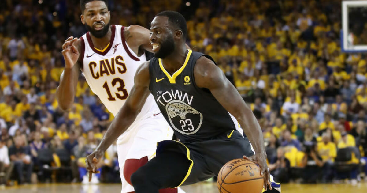 Draymond Green drives past Tristan Thompson during the 2018 NBA Finals