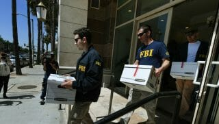 FBI agents remove boxes of documents from the offices of the California Investment Immigration Fund after serving search warrants in an investigation into an alleged USD 50 million high-end visa fraud scheme involving as many as 100 Chinese nationals in San Gabriel, California on April 5, 2017.