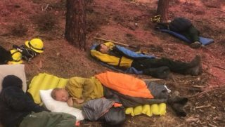 Firefighters Sleeping After Fire
